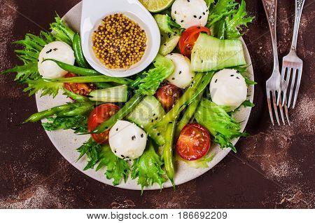 Salad of vegetables with mozzarella. Selective focus.
