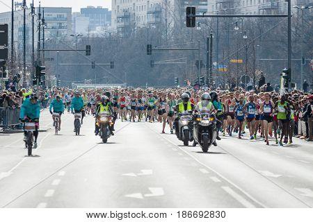 BERLIN - APRIL 03 2016: The annual Berlin Half Marathon. Race through the city streets. Start of the marathon.