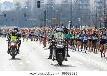 BERLIN - APRIL 03 2016: The annual Berlin Half Marathon. Race through the city streets. Start of the marathon.