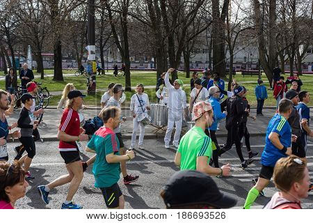 BERLIN - APRIL 03 2016: The annual Berlin Half Marathon. Race through the city streets. Fans with drums.