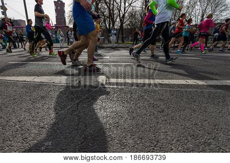 BERLIN - APRIL 03 2016: The annual Berlin Half Marathon. Race through the city streets. Legs of athletes close-up.
