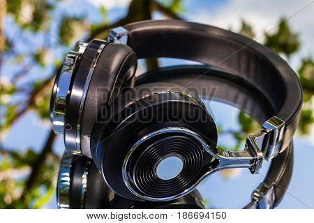 wireless travel headphones on a mirror background