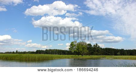 Beautiful summer rural landscape with small lagoon, european countryside