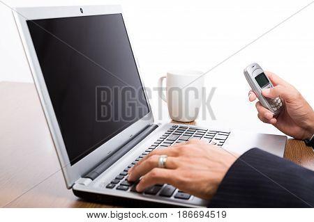 Laptop mobile phone business office work businessman telephone caucasian