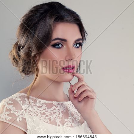 Young Bride. Cute Woman Fiancee with Bridal Hairstyle and Makeup
