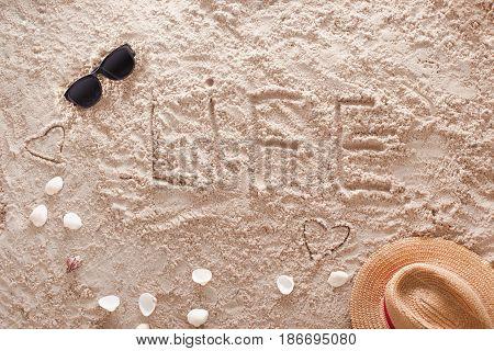 The word Life written in a sandy tropical beach