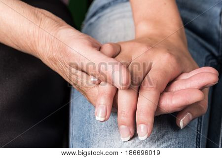 Old hands assistance care holding hands touching elderly