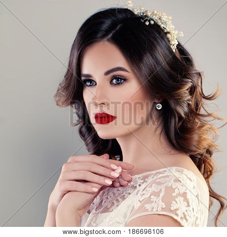 Perfect Portrait of Beautiful Bride with Wedding Hairstyle and Red Lips Makeup