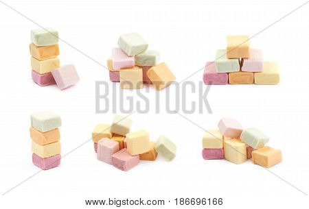 Pile of multiple colorful chewing cuboid-shaped candy gums isolated over the white background, set of six different foreshortenings
