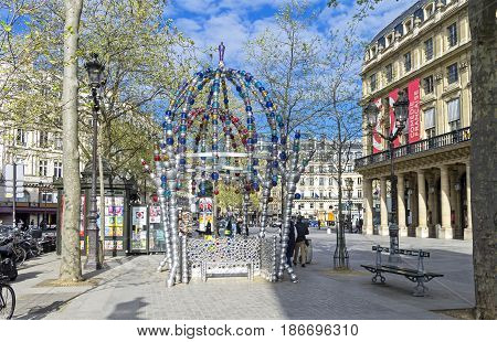 PARIS FRANCE - APRIL 2 2017: Entrance to the Palais Royal - Musee du Louvre metro station. Paris France a sunny day in early April.