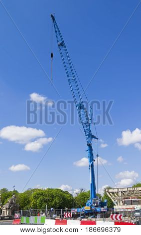 PARIS FRANCE - APRIL 2 2017: A blue crane against a blue sky. A sunny day.