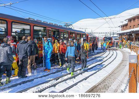 Kleine Scheidegg Switzerland - April 29 2017: the tourist getting on the train at Kleine Scheidegg railway station at Kleine Scheidegg Switzerland.