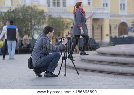 Moscow, Russia - May, 3, 2017: People photograph on Teatralnaya (Theatre) square in a center of Moscow