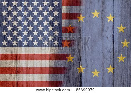 Relationship between the USA and European Union The flags of USA and European Union merged on weathered wood