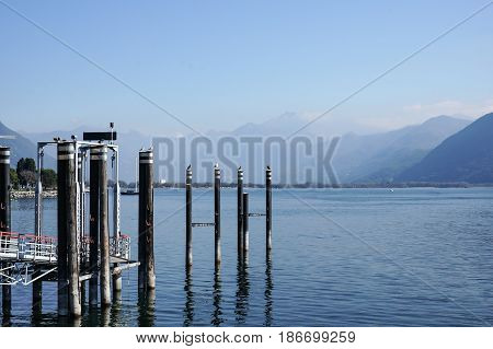 relax view of jetty dock with birds in blue lake summer vacation.