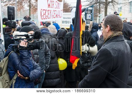 BERLIN - JANUARY 23 2016: Russian Diaspora in Berlin protesting against migrants and refugees due to the sexual abuse of women and children.