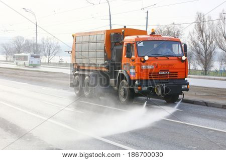Moscow, Russia - April, 29, 2017: street sweeper works in Moscow
