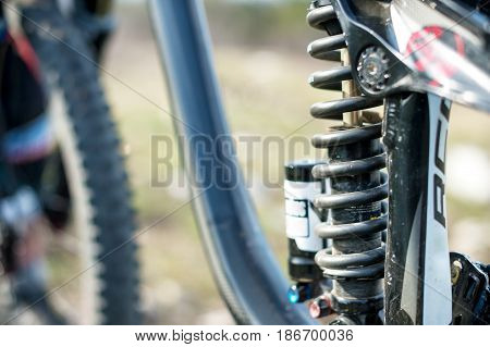 Suspension elements of the mtb bike of a two-pendant mountain bike close-up spring and shock absorber
