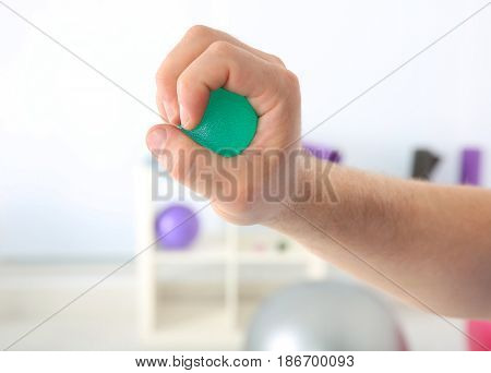 Male hand with stress ball in clinic