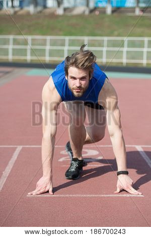 Athletic Bearded Man With Muscular Body Stretching On Running Track