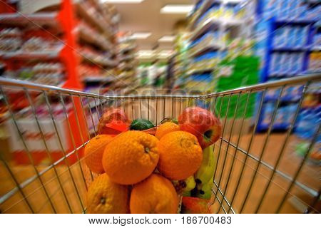 Supermarket shopping cart groceries market aisle retail speed