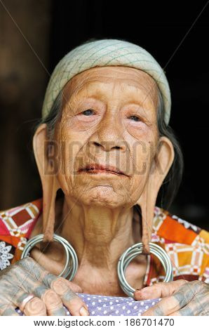 LONG BAGUN BORNEO INDONESIA - 10 JULY 2011: The older Dayak women with traditional long earlobes and tattoo from Borneo