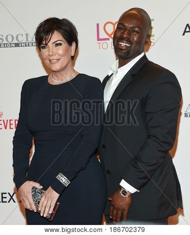 LOS ANGELES - MAY 05:  Kris Jenner and Corey Gamble arrives for the Race To Erase MS Gala 2017 on May 5, 2017 in Beverly Hills, CA