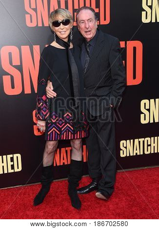 LOS ANGELES - MAY 10:  Eric Idle and Tania Kosevich arrives for the 'Snatched' World Premiere on May 10, 2017 in Westwood, CA