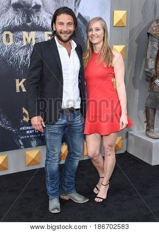 "LOS ANGELES - MAY 08:  Zach McGowan and Emily Johnson arrives for the 'King Arthur: Legend Of The Sword"" World Premiere on May 8, 2017 in Hollywood, CA"