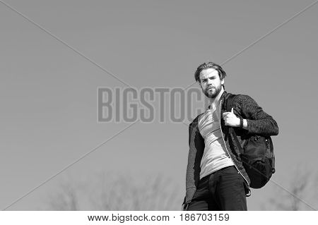 Thoughtful Young Man Against Blue Sky Background With Sport Bag