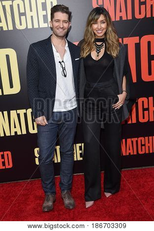 LOS ANGELES - MAY 10:  Matthew Morrison and Renee Puente arrives for the 'Snatched' World Premiere on May 10, 2017 in Westwood, CA