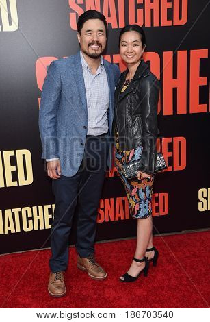 LOS ANGELES - MAY 10:  Randall Park and Jae Suh Park arrives for the 'Snatched' World Premiere on May 10, 2017 in Westwood, CA