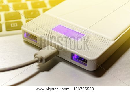 Power Bank Lying On The Surface Of A Laptop