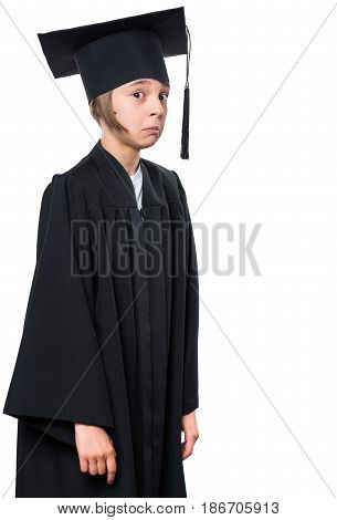 Portrait of a graduate little girl student in a black graduation gown with hat. Child making silly grimace - expressing shocked face - isolated on white background.