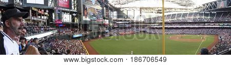 PHOENIX, ARIZONA, MAY 13: Chase Field on May 13, 2017, in Phoenix, Arizona. A Loud Fan Gets Photobombed at a Arizona Diamondbacks - Pittsburgh Pirates major league baseball game at Chase Field in Phoenix, Arizona.