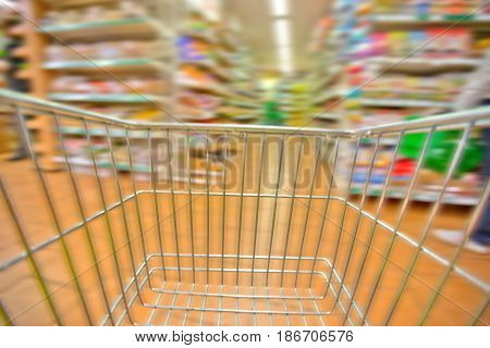 Supermarket shopping cart retail aisle speed blurred motion shelves