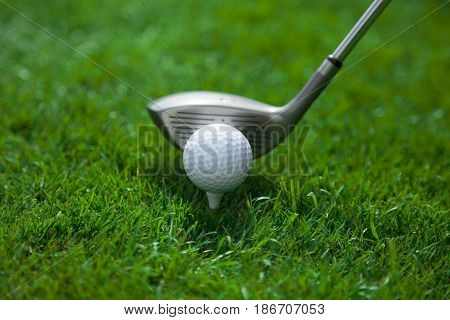 Close-up golf ball golf ball on tee golf tee activity golf equipment hobby