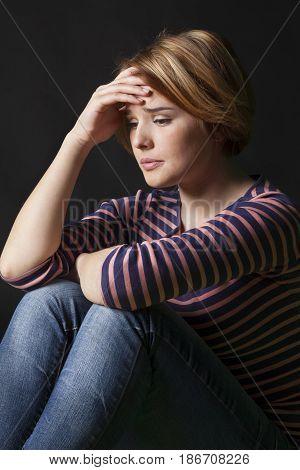 Worried concerned depressed depression upset unsmiling uneasy
