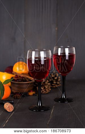 Red Wine And Fruit On A Dark Background.