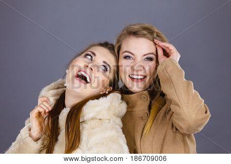 Two Women Wearing Light Brown Coats