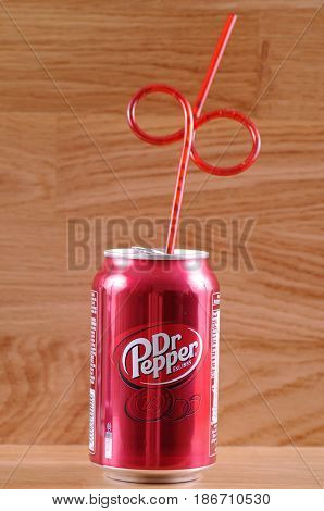 SARANSK, RUSSIA - APRIL 25, 2017: Can of Dr Pepper with tubule on wooden background.
