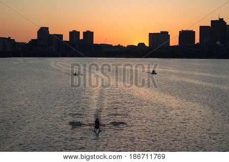 Charles River and rowers during the sunrise