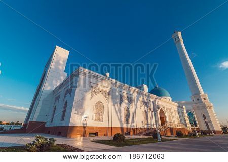 A big beautiful Mosque (Islamic temple) at sunset over blue sky wide angle photo