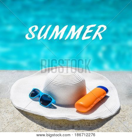 Summer background with hat sunglasses and sunscreen near the swimming pool square format