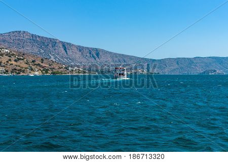 View from the sea on the north coast of Crete on the west side of the Gulf of Elounda. Crete. Greece.