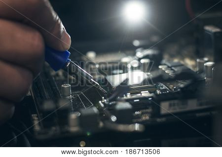 Computer processor. Technician removes CPU from the motherboard.