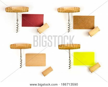 A set of business cards with a cork and a corkscrew, shot from above on a white background. Design templates for a wine list or tasting invitation