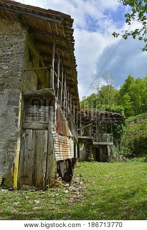 Derelict farm buildings in the small hill village of Iainich in Friuli Venezia Giulia north east Italy