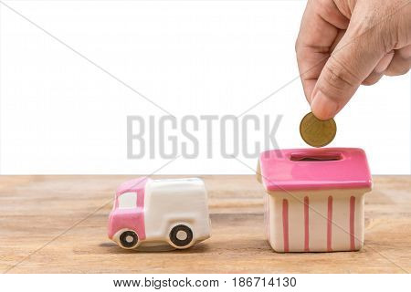 Concept of saving money for house and car piggy bank.Business Finance and Money conceptSave money for prepare in the future.