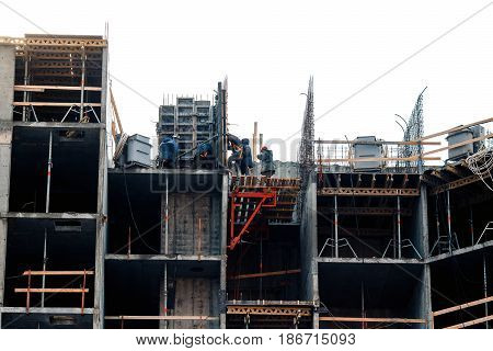Builders are installing a site for the construction of a house. The concept of erecting a multi-storey concrete house.